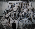 George Milburn his wife and children
